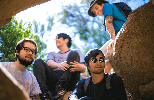 El Paso band Medvedi sittin on a rock in Soledad Canyon in Las Cruces New Mexico